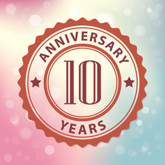 10 Years Anniversary-Retro seal, with colorful bokeh background