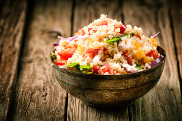 Savory quinoa with herbs, peppers and tomato