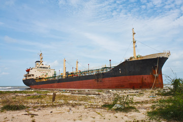 Oil Tanker Ship on dirty the beach
