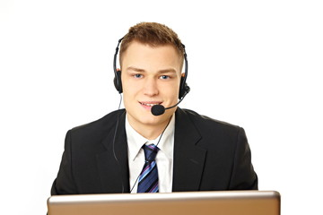 Young customer service operator speaks into microphone
