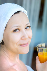 Close up portrait of young smiling woman with a towel hat  and o