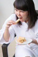 Close-up Portrait of young pretty woman with rage eats wafer , s
