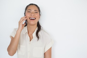 Casual businesswoman laughing on the phone