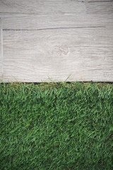 gray ceramic tiles and green artificial grass - top view