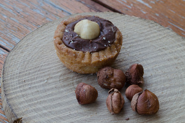 Hazelnuts with some chocolate biscuits