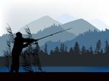 fisherman silhouette near blue mountains
