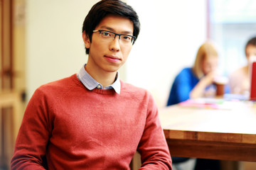 Young asian student in classroom
