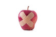 Isolated apple with crossed bandages