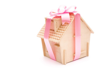 house wrapped with ribbon with clipping path