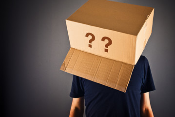 Man with cardboard box on his head questioning