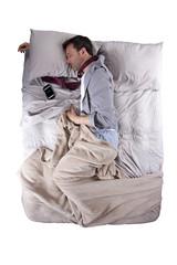 businessman sleeping with cellphone alarm clock