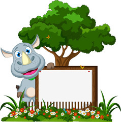 funny rhino cartoon with blank sign on garden