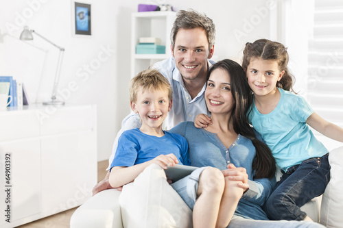 family playing together on a digital tablet - 64903392