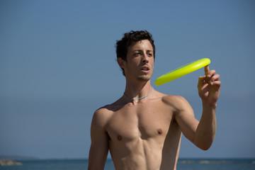 beach guy play with frisbee