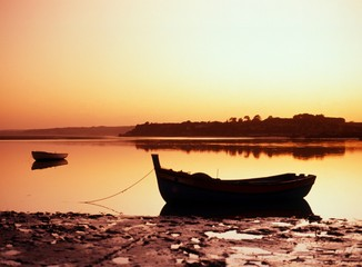 Fishing boat at sunset, Portugal © Arena Photo UK