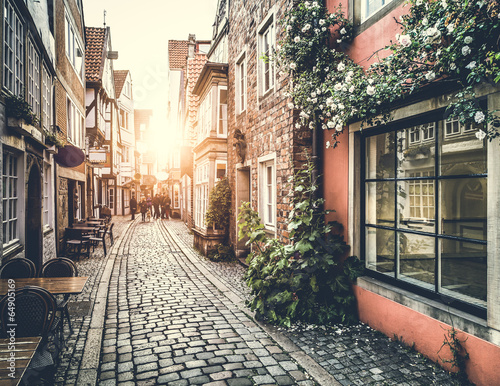 Aluminium Oude gebouw Historic street in Europe at sunset with retro vintage effect