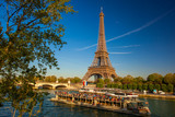 Fototapety Eiffel Tower with boat on Seine in Paris, France