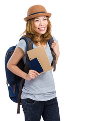 Woman backpacker with holding passport
