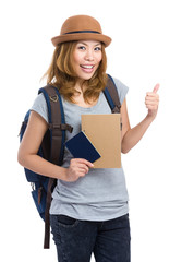 Woman traveler with backpack and passport