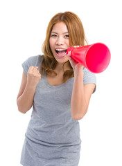 Woman shouting through loudspeaker
