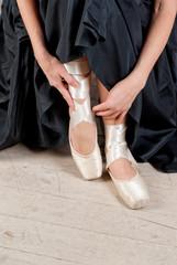Woman's leg in ballet shoes