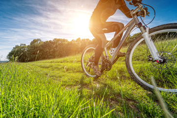 Sport bike, cycling in the beautiful meadow, detail photo,