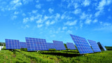 Lots of Solar Panels, with beautiful Clouds - 64906526