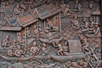 Stone Mural depicting Thai life