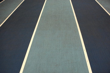 Running track with white lines - close up