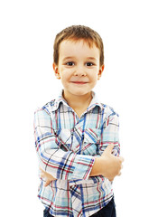 Portrait of a cute little boy standing with folded hands