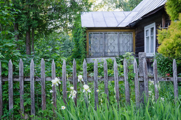 old country house with porch and rustic wood fence