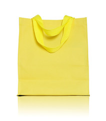yellow canvas shopping bag on white background