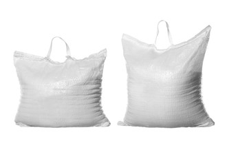 Two bags of white refined sugar isolated on white