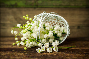 Lily of the valley in a decorative basket