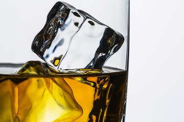 Whiskey glass with ice cubes close-up