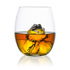 Whiskey glass with ice cubes isolated on white