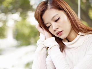 sad asian woman