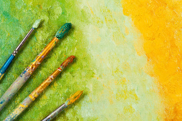Artists brushes on artistic background