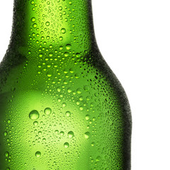 Green bottle of beer with dew drops