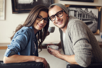 Portrait of smiling couple at cafe