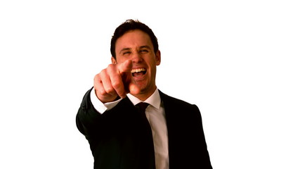 Happy businessman laughing and pointing to camera