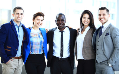 Group portrait of a smiling professional business team