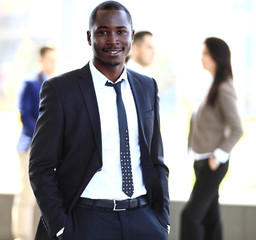 smiling African American business man with executives working