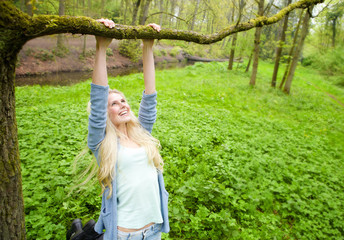 Cheerful young woman playing outdoors