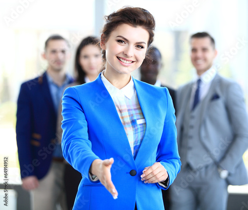 canvas print picture  businesswoman with an open hand ready to seal a deal