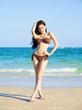 beautiful woman in bikini on the beach at summer day