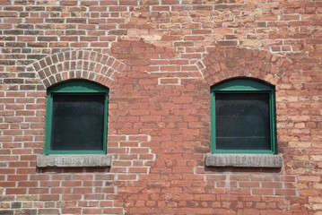 Windows in a brick walled building