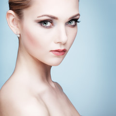 Beautiful  girl, isolated on a light , emotions, cosmetics