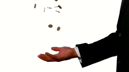 Businessman catching falling coins in hand