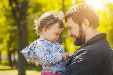 happy father and baby playing in the park